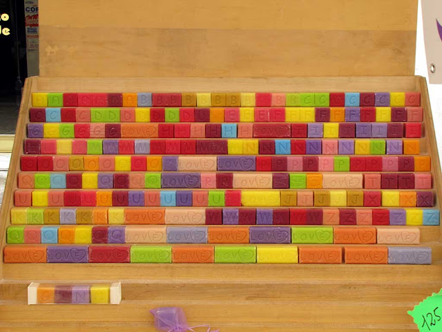 Colorful soap cubes with alphabet letters, via Guglielmo Oberdan, Pisa