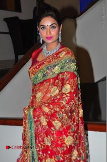 Model Sharon Fernandes Stills in Red Saree at Trendz Exhibition Launch  0014.JPG