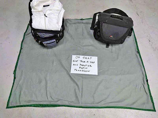 camera bag, backpack sign