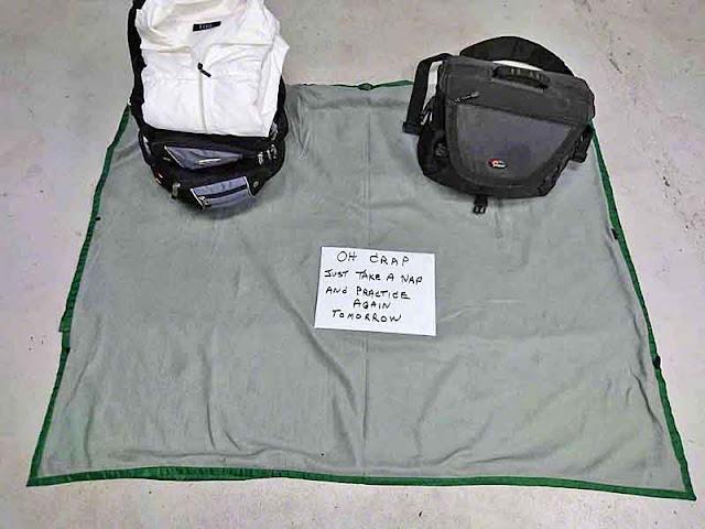 camera bag, backpack sign