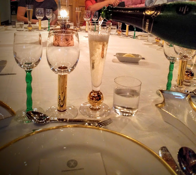 A glass of champagne poured at the Nobel Prize dinner at Stadshuskällaren Restaurang at the Stockholm City Hall