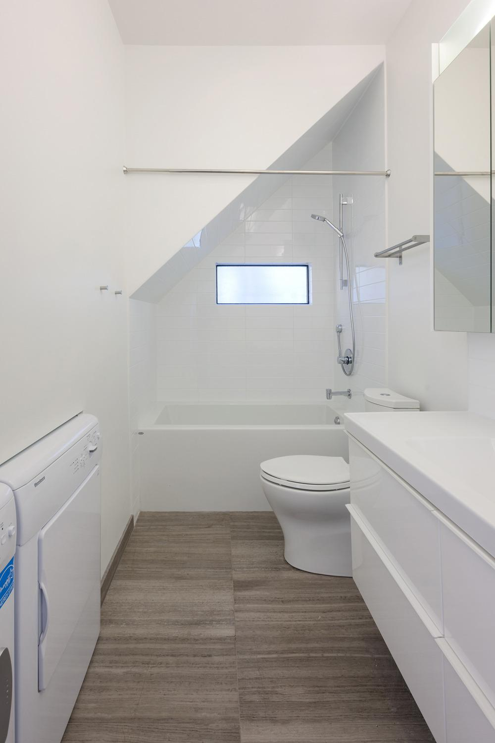 small attic bathroom sloped ceiling