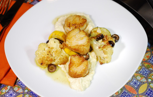 Scallops, Roasted Veggies, and Preserved Lemon Cauliflower Cream. Recipe by Nicole Ruiz Hudson. Photo by Greg Hudson.
