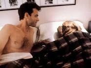 cães dormindo na cama