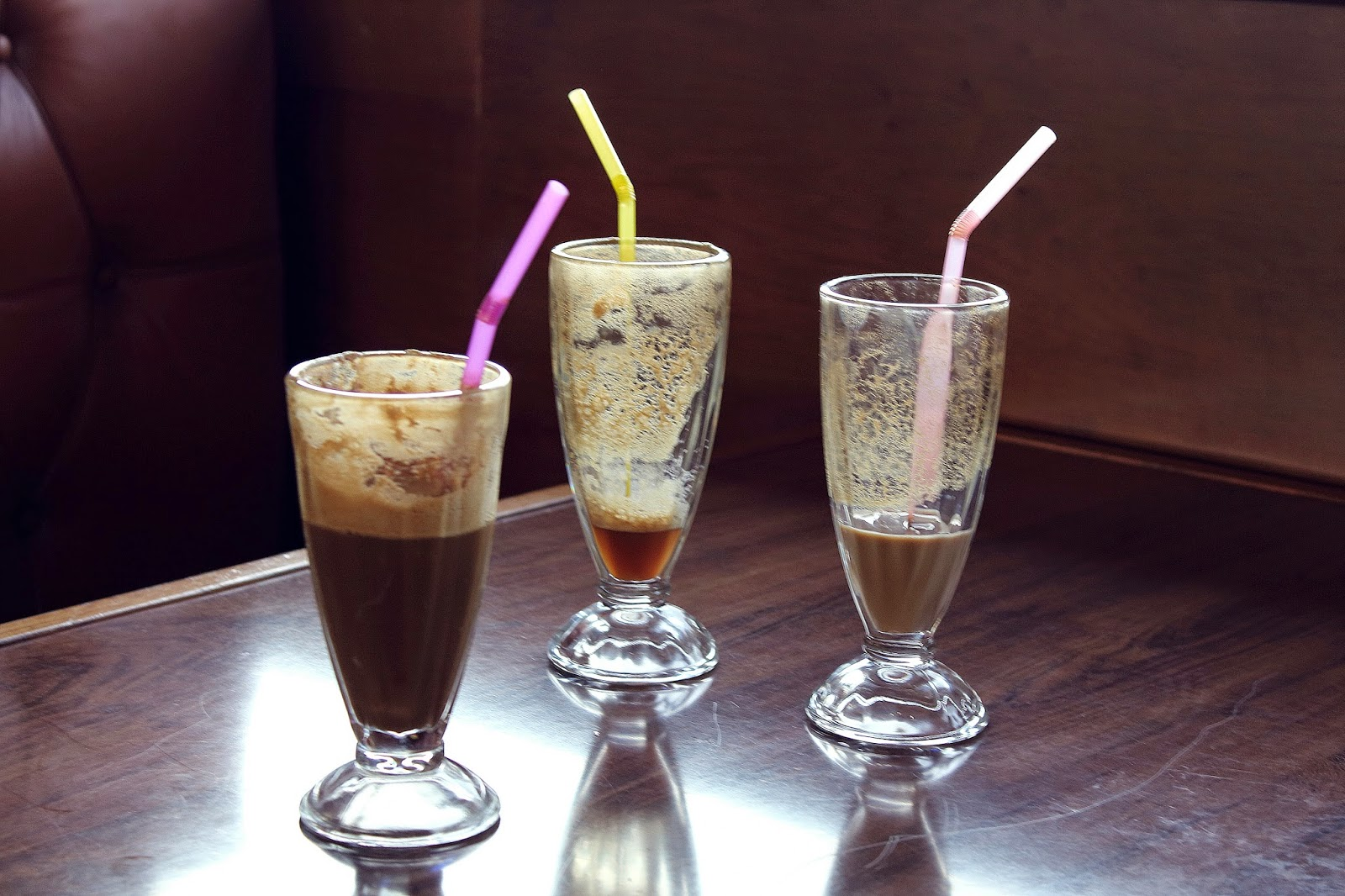 three glasses of iced coffee