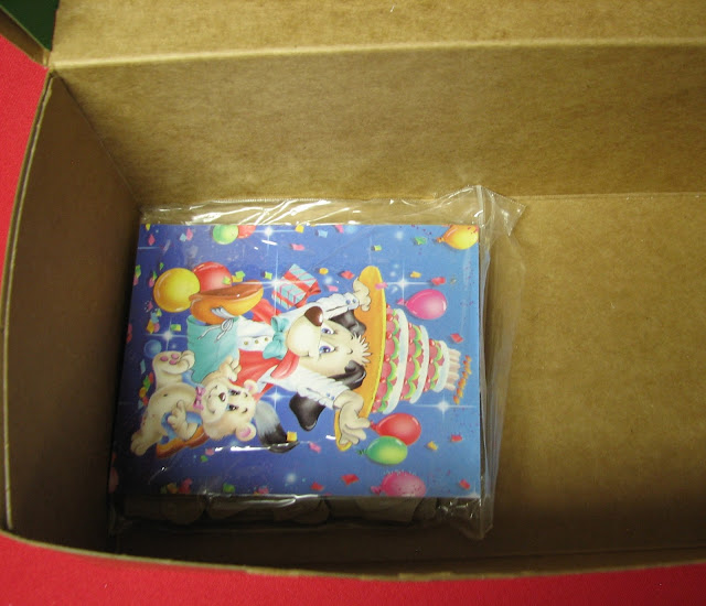 Puzzle in bag with image taped on in OCC shoebox