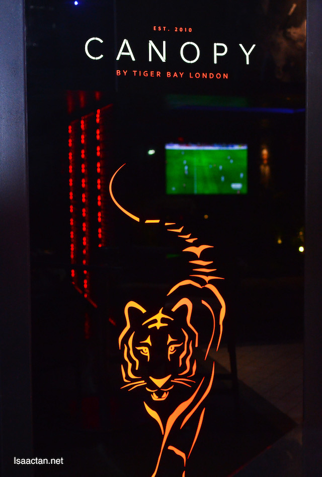 Tiger themed emblem of Canopy Rooftop Lounge