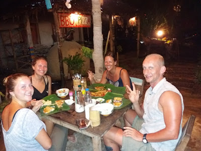 photo of Ellis and 3 other travellers having dinner from banana leafs