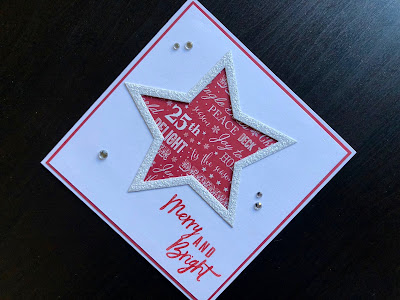 Hand made Christmas card with a die cut star shape and stamped greeting