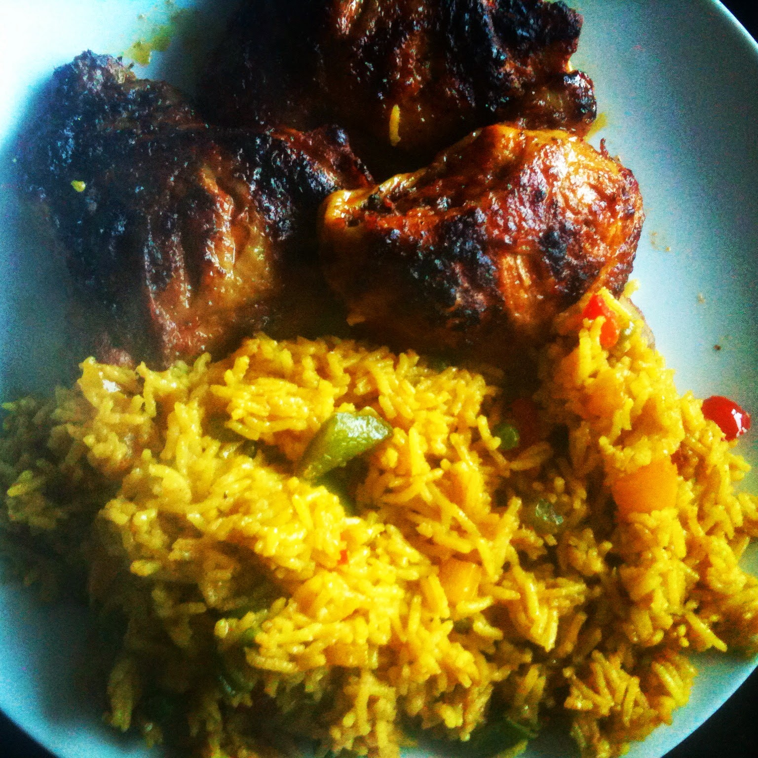 Dinner of peri peri chicken and rice is served