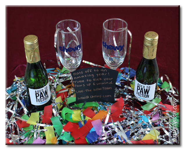Chewy champagne glasses and two bottles of bubbly with confetti for New Year's