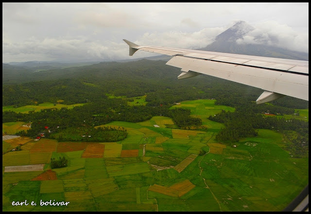 Bumpy Plane Ride, A Rainbow and First Glimpse of Mount Mayon