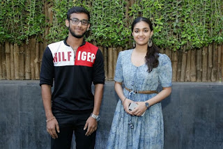 Keerthy Suresh in Blue Dress with Cute and Lovely Smile with a Fan 9