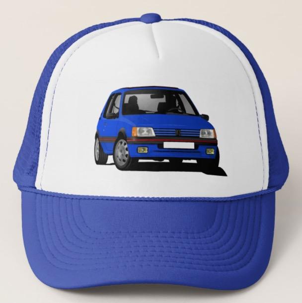 Cornering Peugeot 205 GTi in blue trucker hat