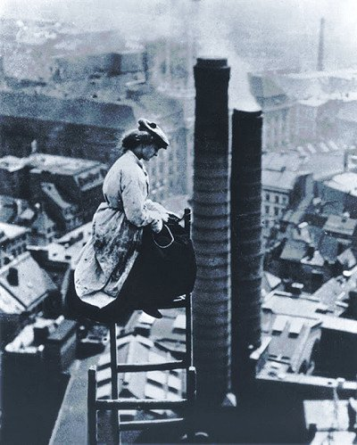 Berlin 1910, lady mason on a ladder high above a smokey city