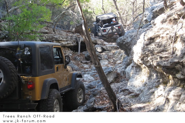 JK Jeeps moving through a mild trail