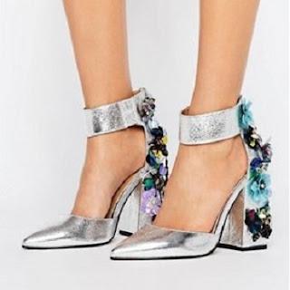 Schuhe mit hohen verzierten Absätzen - über asos.de