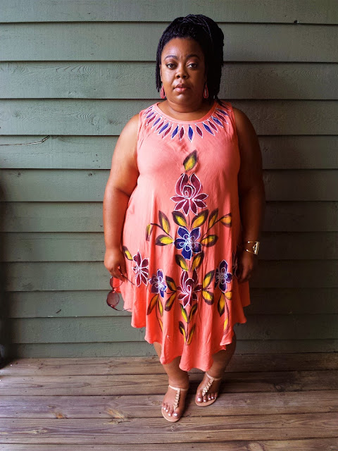 Painted dress, full hips, nude sandals, faux locs