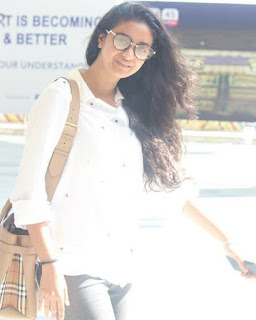 Keerthy Suresh in White Dress with Cute and Awesome Lovely Smile at Hyderabad Airport 4