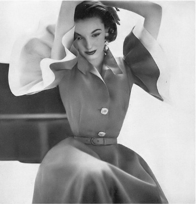 Model in mocha silk organza dress with rhinestone buttons and white  organza lined ruffled sleeves by Jo Copeland. Photo by Richard Avedon,  Harper's Bazaar, April 1951