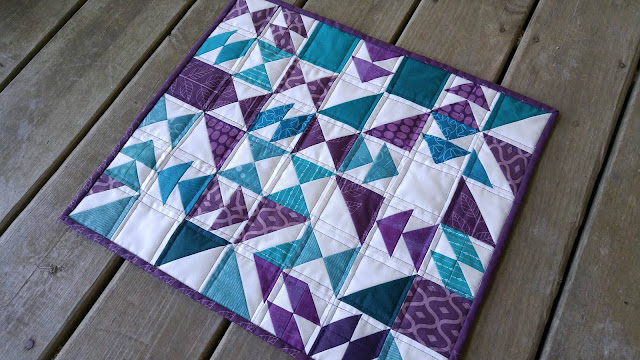 mini purple and teal chaos quilt turned into a puzzle