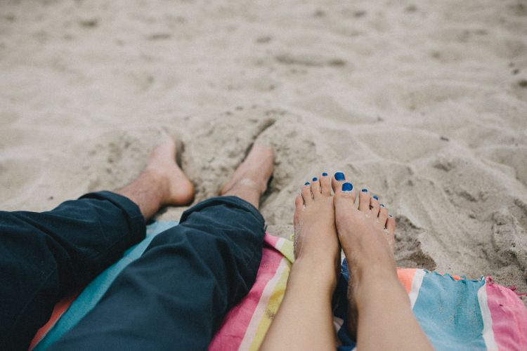 couple at the beach spending time together