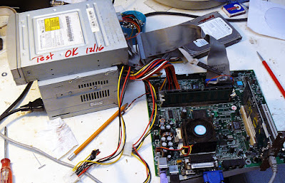 old computer motherboard on the test bench
