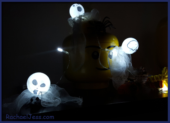 Ping Pong balls, netting, glue and some LED Lights make great Halloween decorations