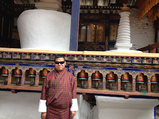 Photo of myself standing in front of a stupa in Paro
