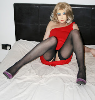 Cute transvestite masker flashes knickers in short red dress