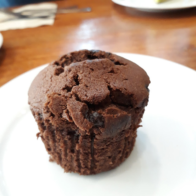 Choco muffin-  A small domed cake with chocolate chips on top.