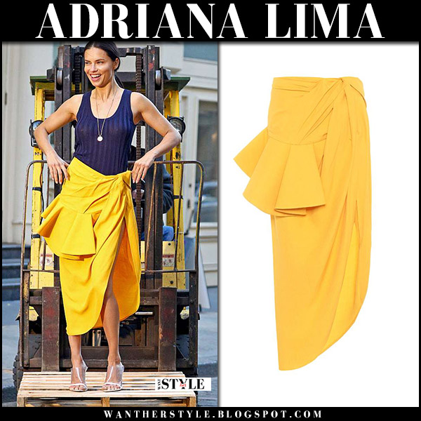 Adriana Lima in yellow asymmetric skirt jacquemus and blue top spring style april 20