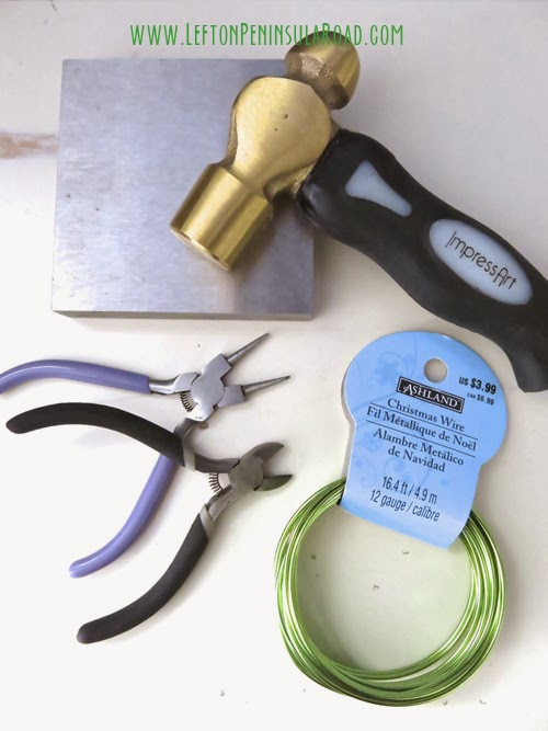 Steel Bench Block, Stamping hammer, wire and other tools for diy Shamrock necklace.