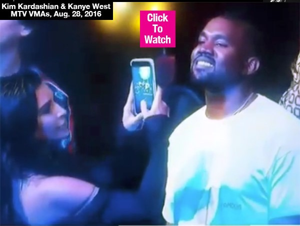 Kim Kardashian Gets Annoyed Taking Selfie As Kanye Stares At Rihanna At VMAs