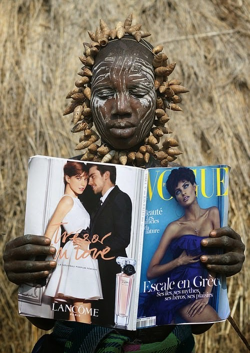 A Mursi tribe woman discovers Vogue magazine, Ethiopia. - The 63 Most Powerful Photos Ever Taken That Perfectly Capture The Human Experience