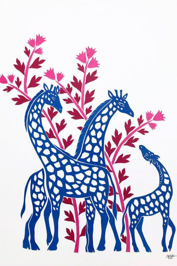 three blue paper cut giraffe silhouettes surrounded by pink and red floral design