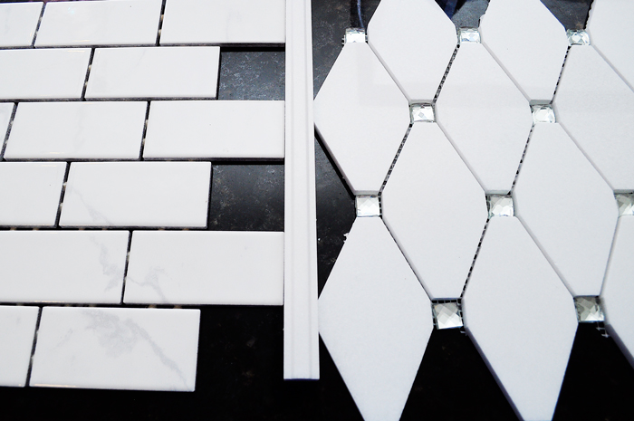 Thassos Diamond Reflection Tile for a Kitchen Backsplash Accent in a white kitchen with shaker cabinets | via monicawantsit.com