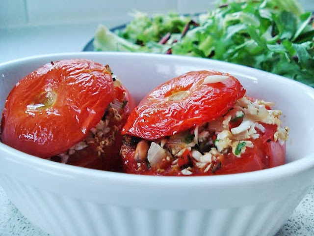 A serving bowl of stuffed tomatoes