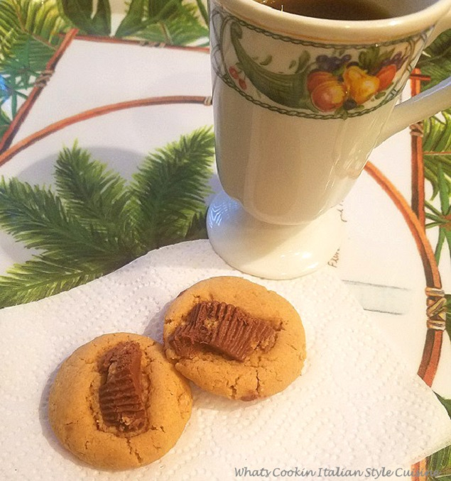 these keto baked peanut butter cookies are made with sugar free sweetener, sugar free peanut butter cups on top, sugar free peanut butter an egg baked on a silipat mat