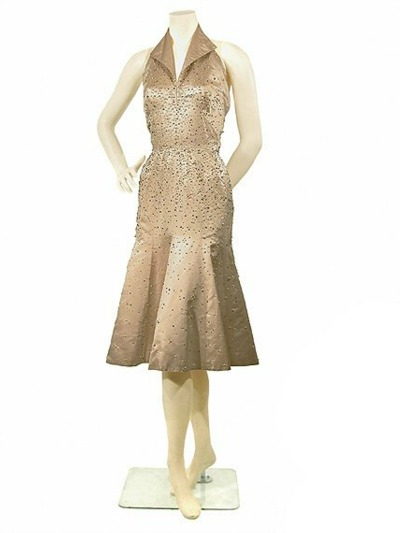 Pauline Trigere nude colored 1950's halter neck evening dress displayed on mannequin