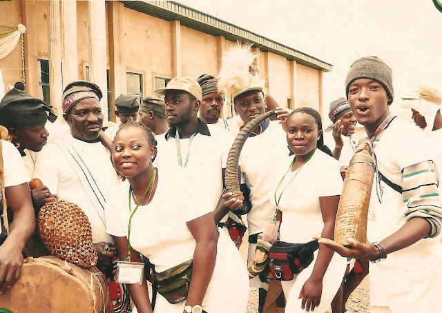 Plateau state natives in costume after a music performance posing with corp members