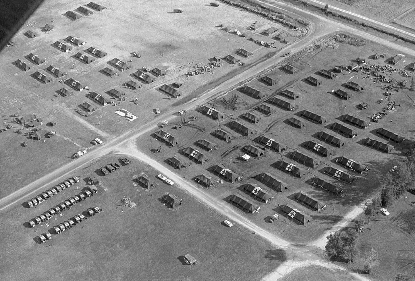 A group of U.S. Army hospital tents and ambulances, set up at the Opa Locka airport, formerly a marine air station in Miami, Florida in November of 1962.