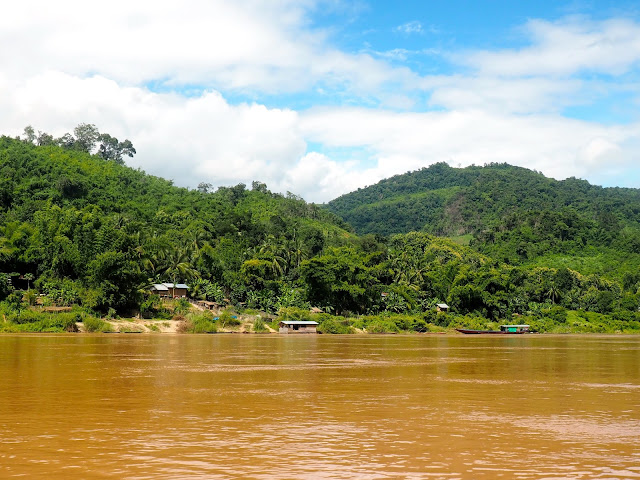 Houses and boats on the banks of the Mekong river, Laos