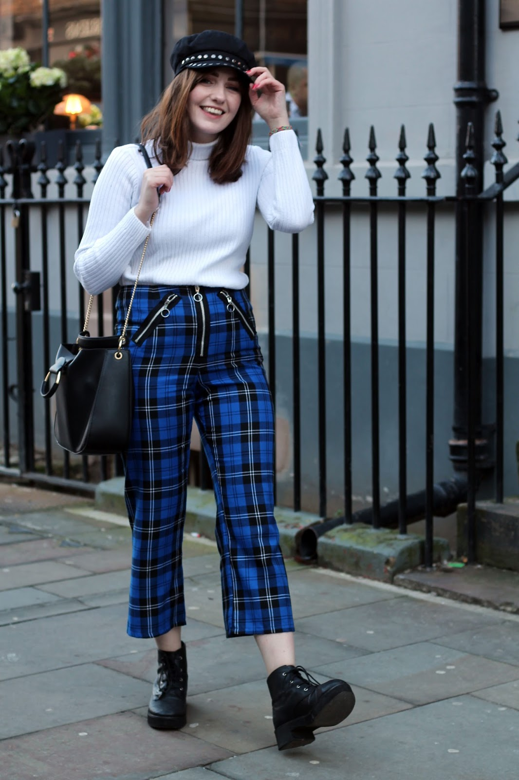UK style blogger in tartan kick flare trousers