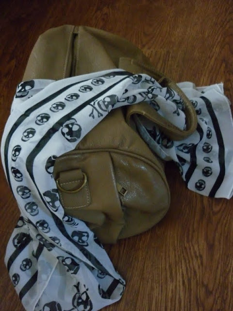 focco bag beige bag with studs underneath and white and black monochrome skull print scarf