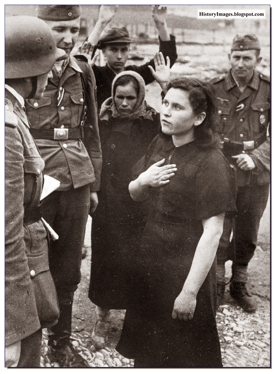 German soldiers listen carefully  Russian lady  saying. Novorossiysk, 1942 Rare WW2 Images