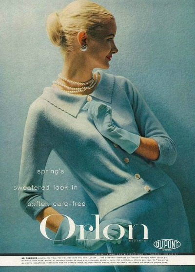 Model wearing a robin's egg blue sweater set in February Vogue 1956 Dupont Orlon Ad