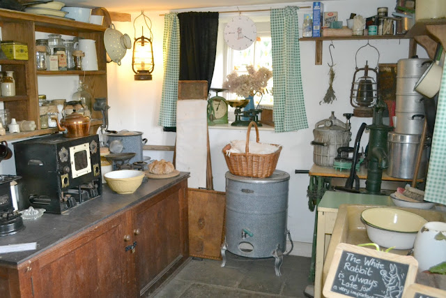 The pantry of Wartime Cottage with lots of old supplies