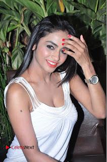 Actress Model Pooja Sri Stills in White Short Dress at F Club pre soft Launch  0162.JPG