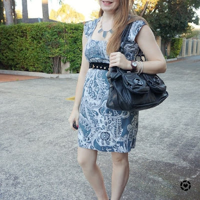 awayfromblue instagram | black accessories and button bag with blue paisley print office sheath dress